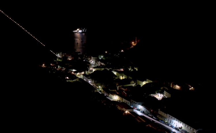Jamestown at Night. Showing Jacobs Ladder rising steeply to the left ad the RMS St Helena anchored in James Bay