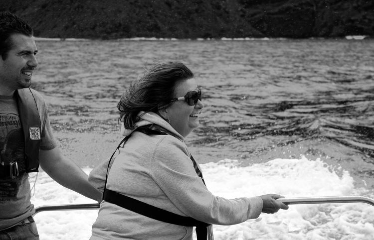 Looking every bit the Lady of the Island Christine hangs on for dear life!