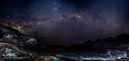 This complicated photo involved a lot of work and is by no means perfect. The foreground requires a lot of light to be cast on it, so during a 20 second exposure, two off camera flashes are fired twice each to through some light on the foreground and distant rocks. Second exposures are then used to captre the skies. Finally a third set of images were needed to get the very nearby rocks in foucs against the distant stars. All in, 22 photos are then layered and stitched into this large panorama.