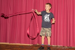 Oliver showing his new circus skills on stage.