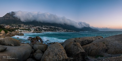 Camps Bay with the Twelve Apostles covered in a tablecloth of cloud